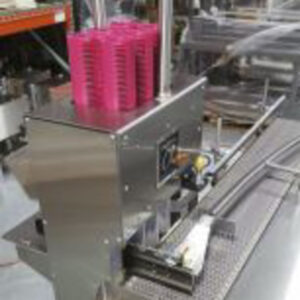 Minigun auto Paktech applicator for beverage canning and distribution