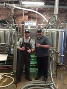 Sharing a Beer After Commissioning a Brewhouse